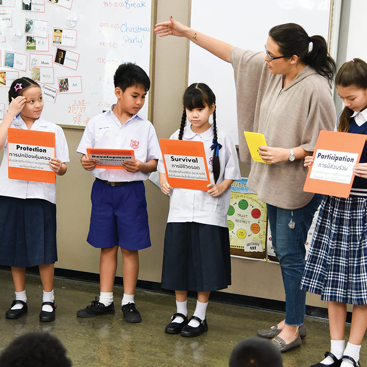 Provide Education to Keep Students Safe: Group of young students in classroom