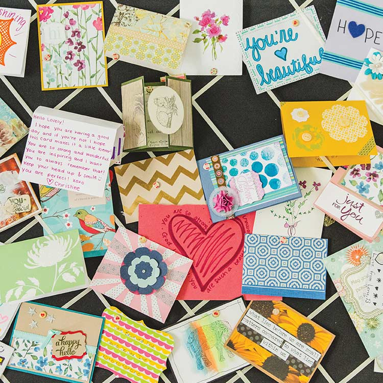 A care package of hand-written letters for survivors in A21's care