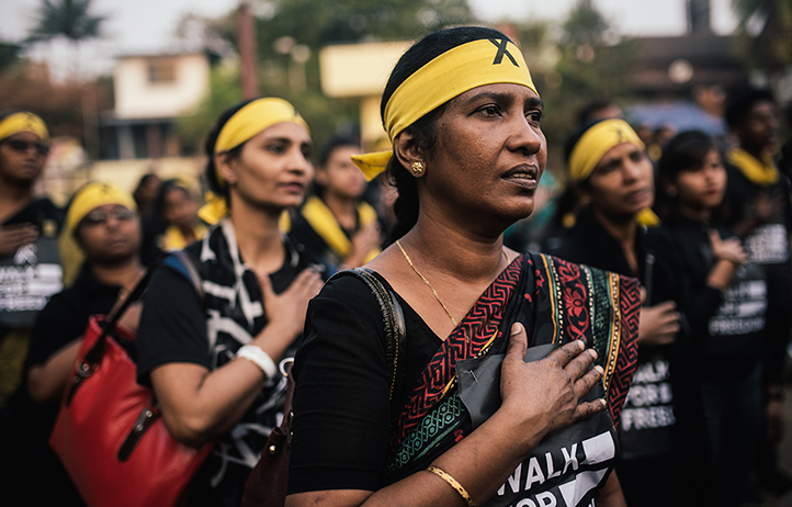 Walk For Freedom 2018: Woman with bandana on forehead; close up; hand on chest